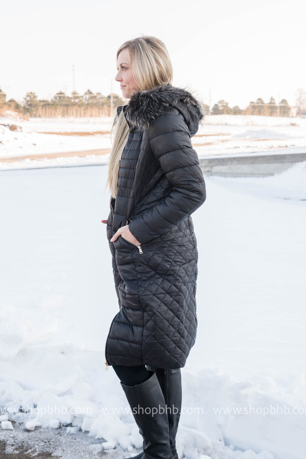 This fur trimmed hooded long coat is the perfect winter coat with its fur lining.