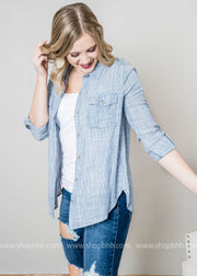 This navy and white striped button up top is a true nautical classic top.