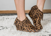 Check out this leopard wedge bootie with those fringe details.