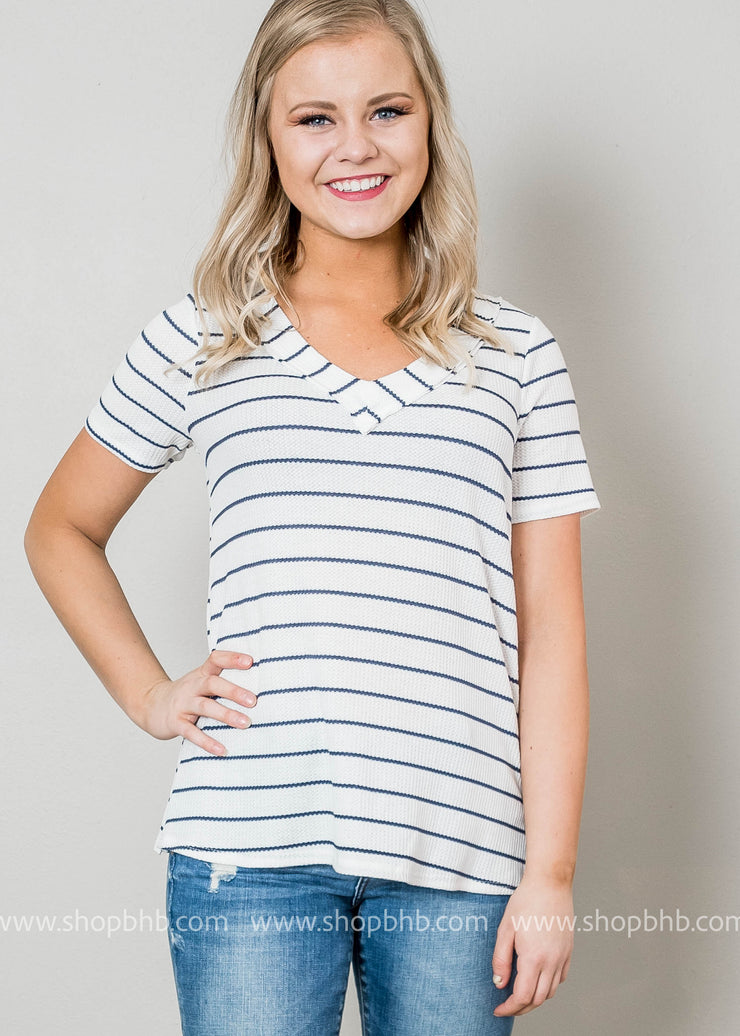 This ivory v-neck short sleeve tee with navy stripes is the perfect top to sail away into the sunrise.