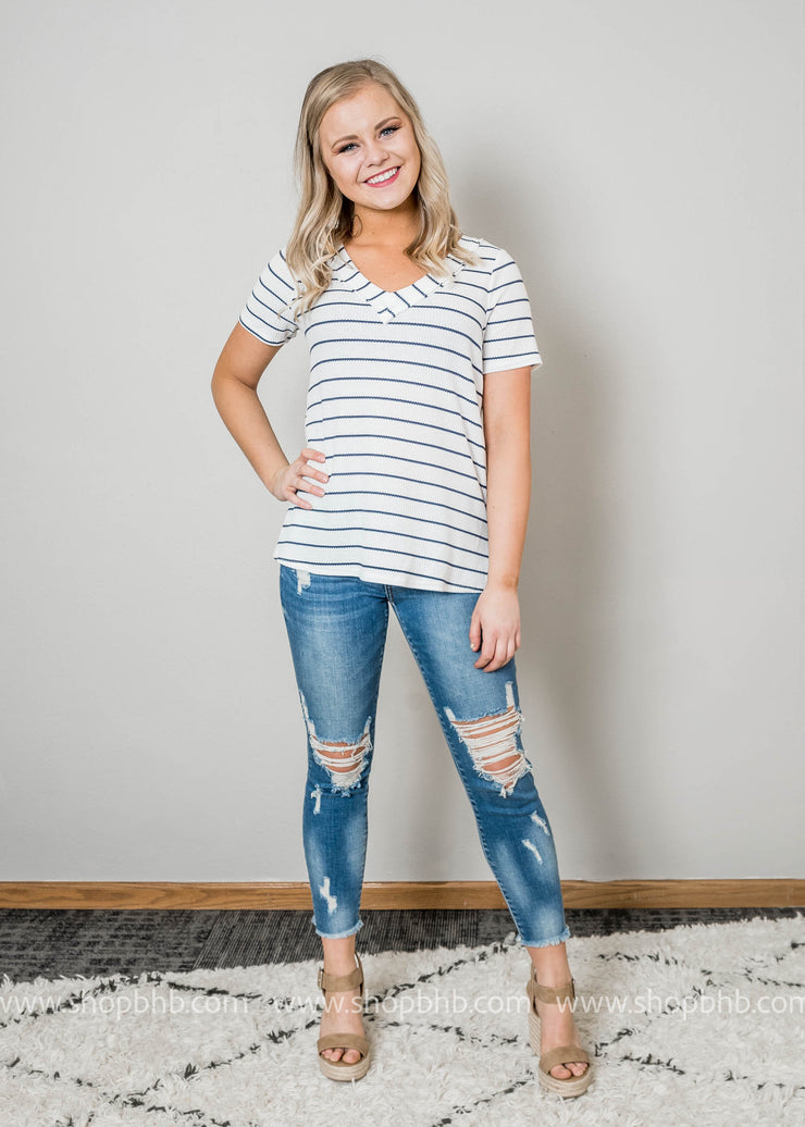 Loving this ivory striped top, Sailing away striped top, with v-neck and navy stripes.