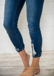 It is all about the details.  We love the tiny amount of distress in this Mid Rise ankle Skinny Jeans.