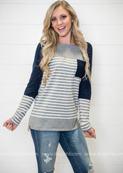 This Quirky Color Block Striped sweater in gray/ivory with a touch of navy splashed on the sleeves and pocket is the perfect sweater!