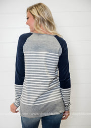 Check out the back of this quirky striped color block sweater.  Who is ready for Sweater Weather?