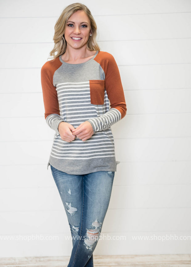 Sweater weather is among us and this splash of copper in this Quirky Colorblock sweater is adorable.