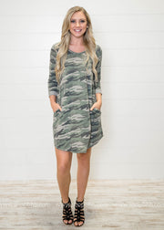 This 3/4 sleeve camo dress features pockets!!  We love to style it chic with heels or street with rider boots....either way this Camo Dress is sure to my a fashion favorite!