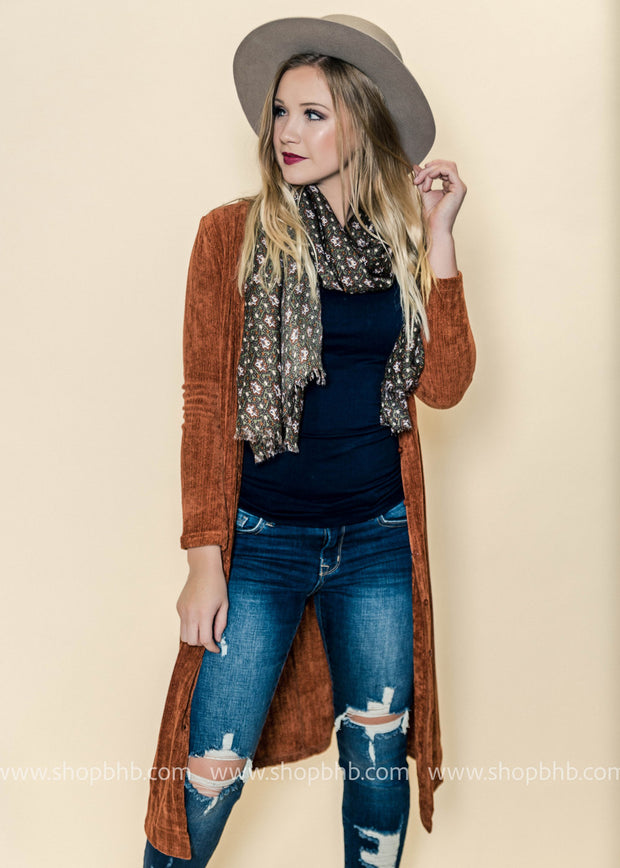 This ribbed chenille like duster in rust hits right below the knee.