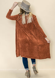 This back of this chenille like ribbed rust duster cardigan shows the softness of the this cardigan.