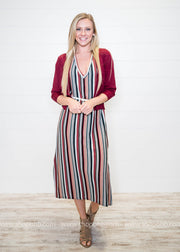 Add a cropped cardigan and a belt to this multi stripe ankle length dress.