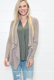 Our ribbed cardigan is perfect for your work week
