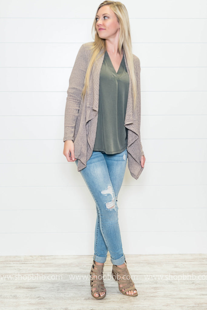 We love nuetral cardigans and the flyaway look