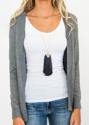 grey black shaggy necklace
