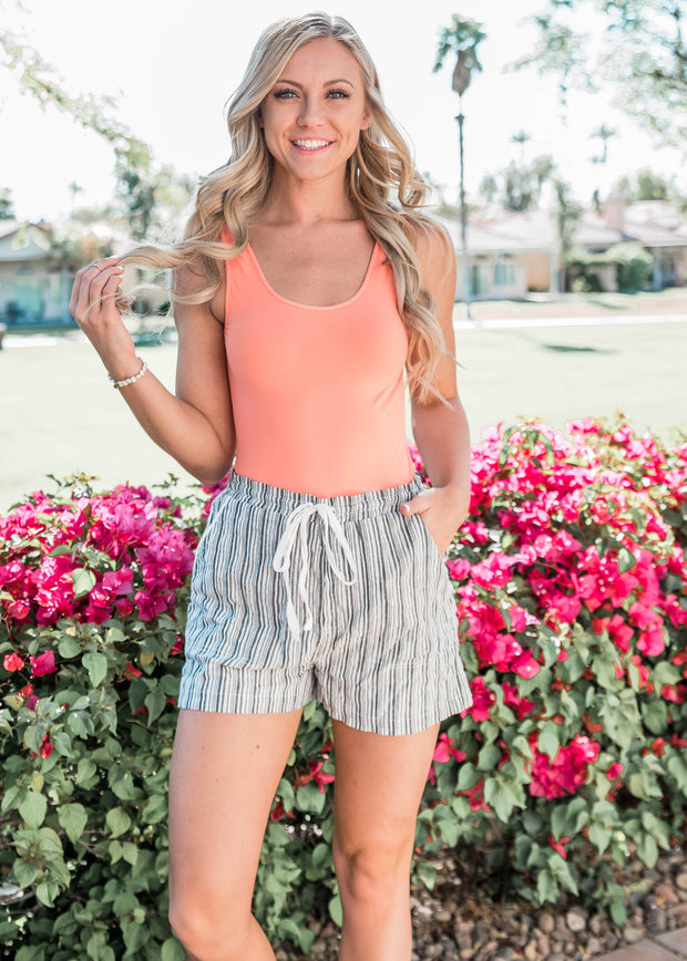 Coral seamless tank featuring wide straps