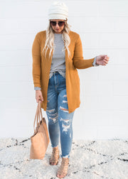 mustard light weight knit cardigan with it's pointelle details aka lace effect