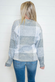 Our favorite part of this plaid sweater is the varying colors of grey