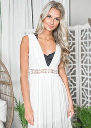 White maxi sun dress for summer.  Floral crochet waistband and eyelet detailed maxi dress.