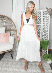 White deep v-neck maxi dress with a detailed waistband.  White maxi dresses for brides.