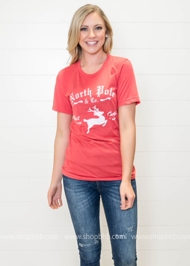 Short sleeve holiday tshirt featuring a vintage holiday saying on it.