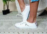 White slip-on sneaker with a slight color pop on the back heel.
