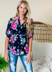 3/4 sleeve navy top with pops of pink floral design.  Floral blouses for women.   Floral blouses for Spring.