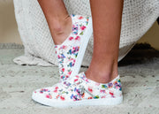 Blowfish white floral slip on sneakers with zipper detail on the side.