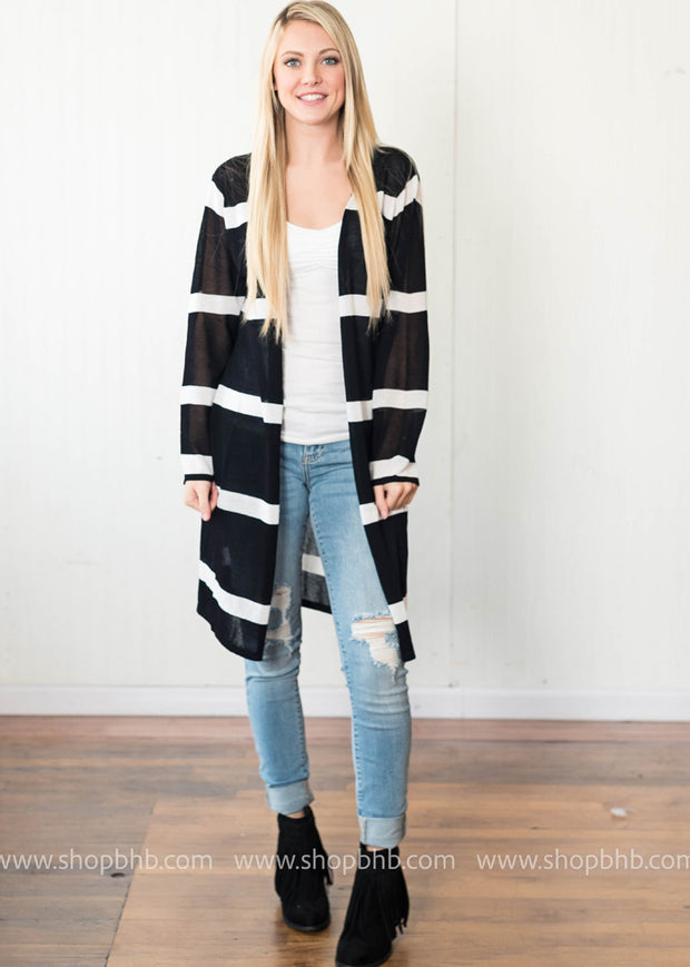 Our wide striped black and white cardigan is the perfect length for boho look.
