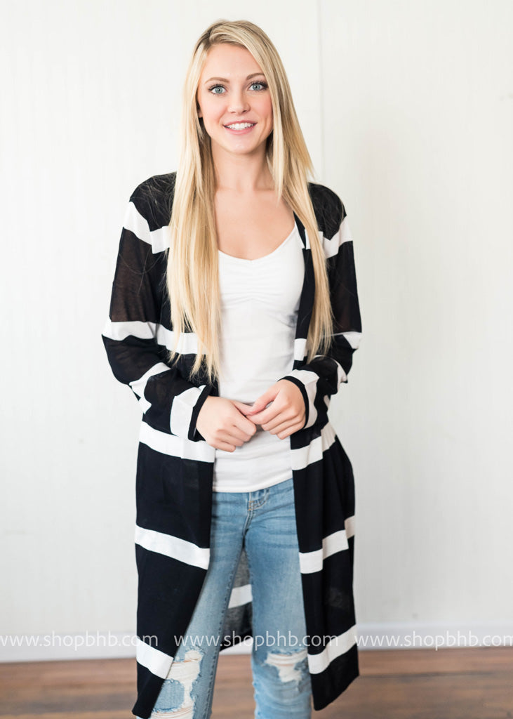 Our black and white striped cardigan is lightweight enough for warmer days.