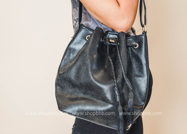 black tassel over the shoulder hand bag