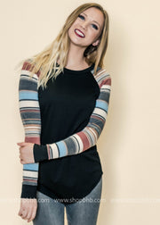 We love the striped sleeves on this top, perfect to pair up with a vest