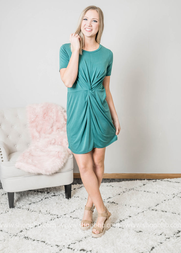 Green short sleeve dress with knotted detail at waist to add defination
