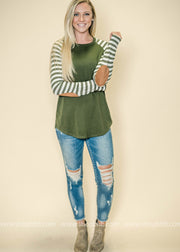We are all about this hunter green striped top