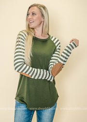 Love a good suede elbow patch on our striped colorblock top