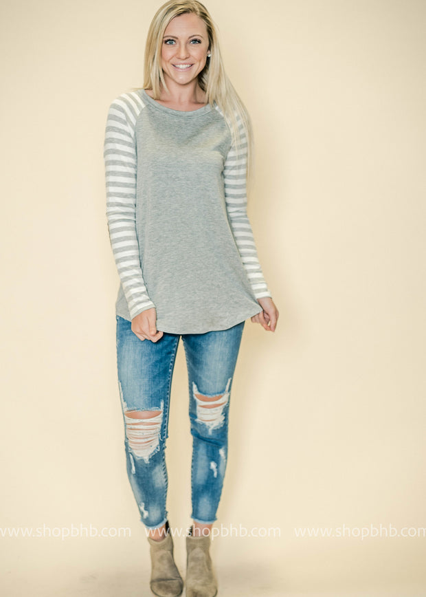 Our gray striped top with elbow patches is great with denim