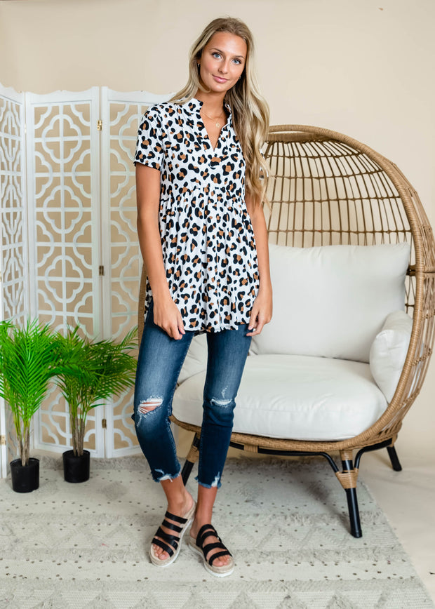White leopard print baby doll short sleeve blouse.