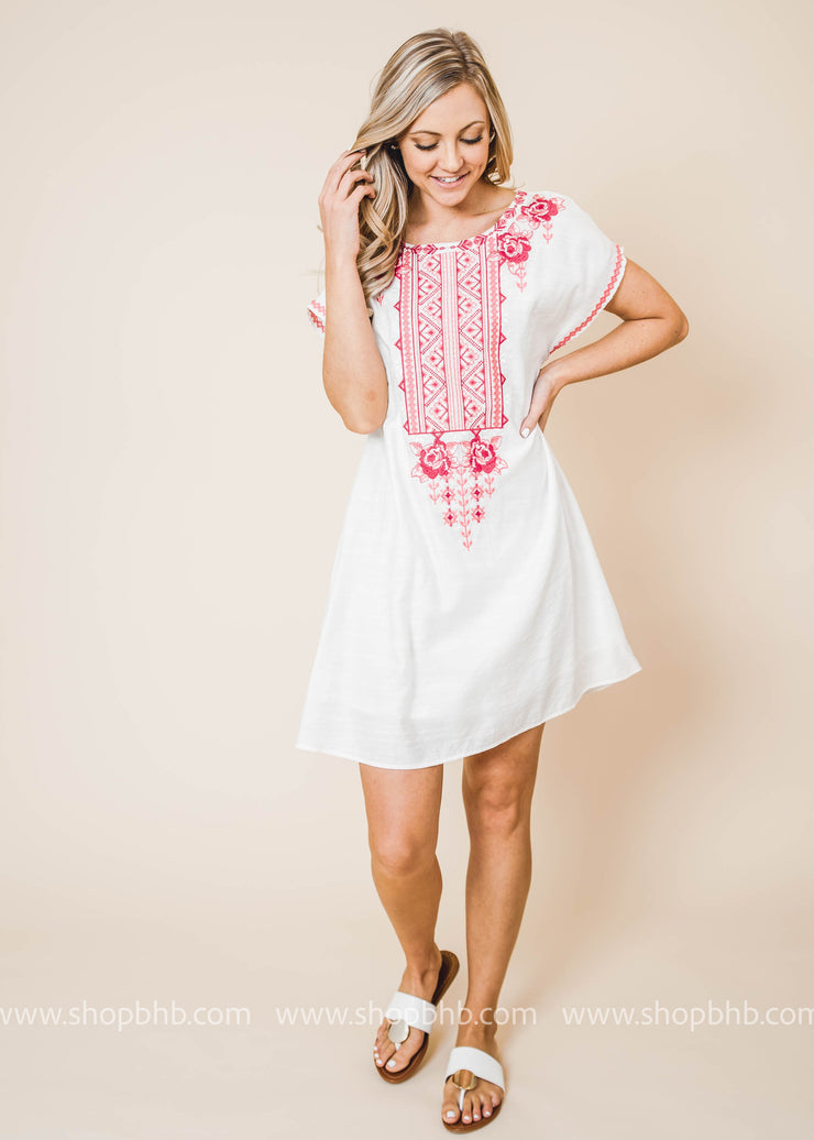 This dress features a dolman sleeve, round neckline and a beautiful embroidered front.