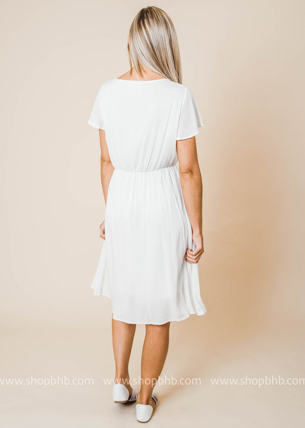 Crinkled gauze flowy dress. Has V-neckline, ruffled 1/2 sleeves, elasticized waist and skirt under layer