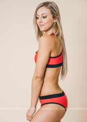 red two piece sporty swimsuit with zipper features on the top and bottoms