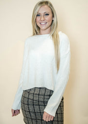 Go for a preppy look in our white chenille sweater with plaid skirt