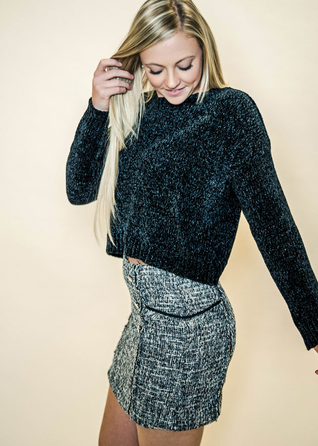 This black chenille sweater looks amazing with our winter skirts