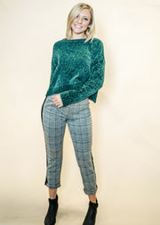 Channel those Holiday vibes with this vibrant green chenille sweater.