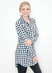 Wear our black and white buffalo plaid tunic with a pair of leggings and tall boots
