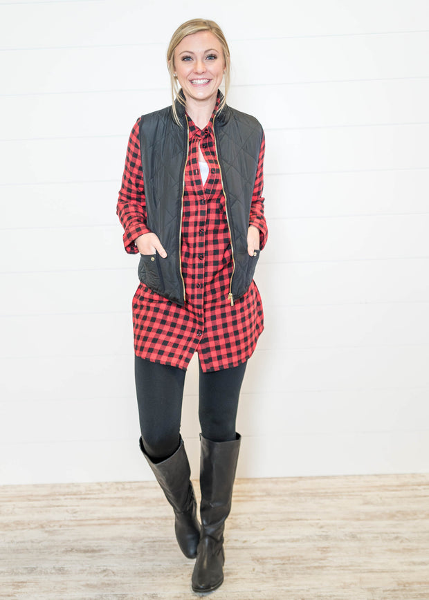 Pair your buffalo plaid tunic with a black quilted vest and leggings