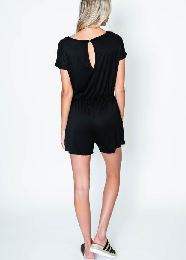 black short sleeve romper with keyhole button closure in the back