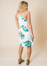 shift dress features a tropical print and a v-neck and thin straps that meet into a racer back.