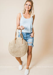Round Bamboo Bag featuring leather straps