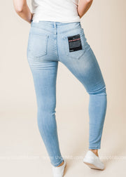 Medium blue faded mid rise skinny jeans in a soft light rayon fabric