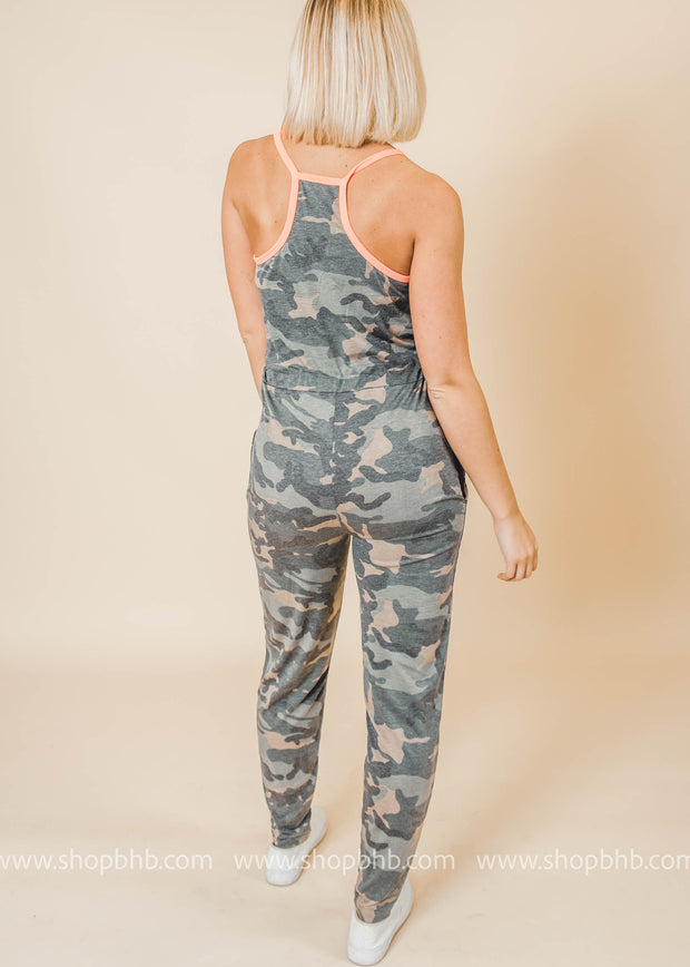 camo jumpsuit with neon coral trim