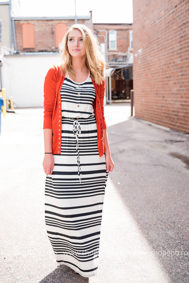 Our Black and white striped maxi paired up with our classic snap front cardigan.
