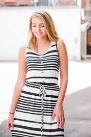 Close up of black and white striped maxi featuring drawstring waist.