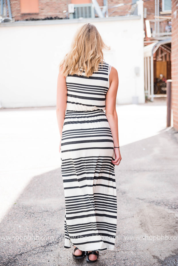 Back view of our black & white striped maxi dress.